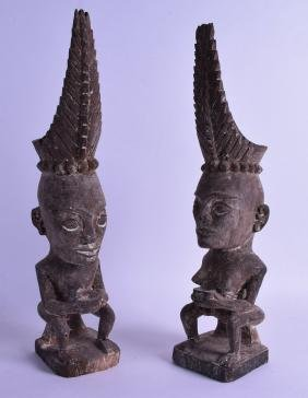 A PAIR OF EARLY 20TH CENTURY SUMATRAN CARVED WOOD