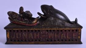 A LOVELY ANTIQUE JONAH AND THE WHALE CAST IRON MONEY
