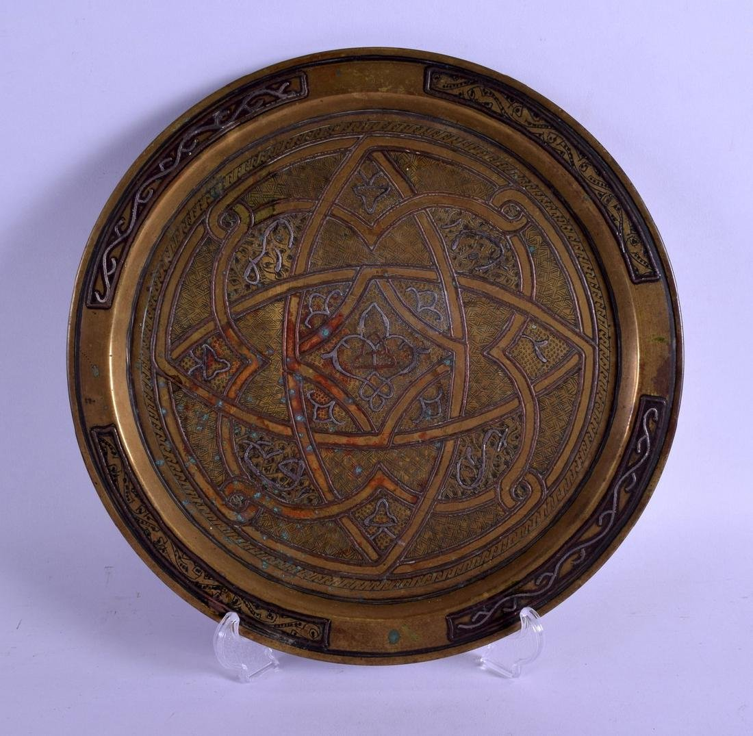 A CAIRO WARE SILVER AND COPPER INLAID CIRCULAR DISH