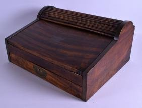 A LARGE 19TH CENTURY MAHOGANY ROLL TOP CAMPAIGN WRITING