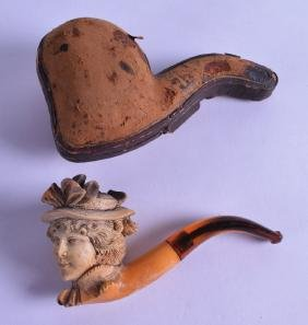 AN EARLY 20TH CENTURY CASED MEERSCHAUM AND AMBER PIPE