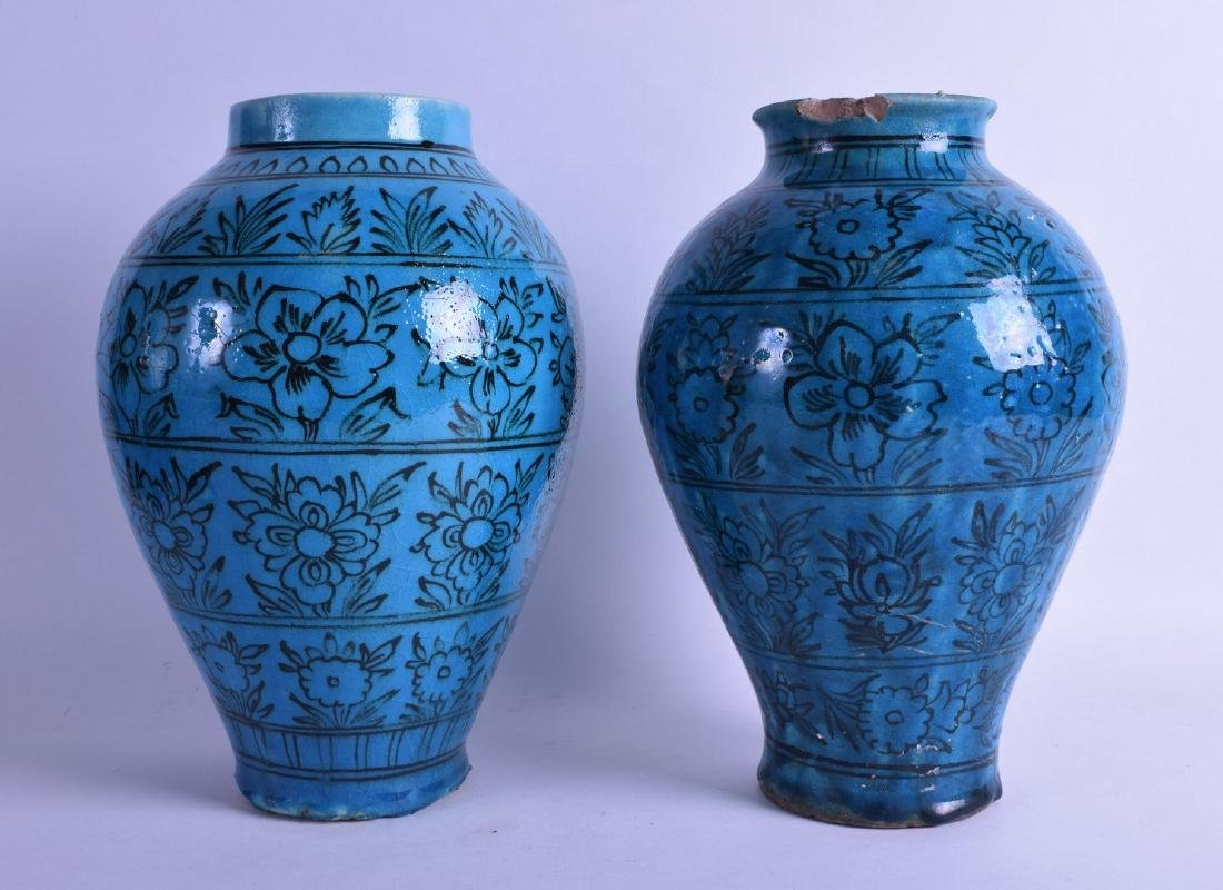 A PAIR OF PERSIAN BLUE GLAZED BALUSTER VASES painted