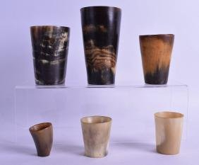A SET OF SIX ANTIQUE HUNTING BEAKERS of various sizes.