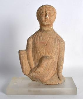 A CYPRIOT LIMESTONE FIGURE OF A MALE 6th/7th Century,