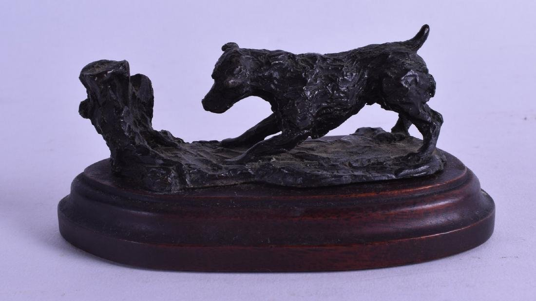 A SMALL BRONZE FIGURE OF A HOUND Signed Piglet 83. 12