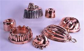 A GOOD COLLECTION OF VICTORIAN COPPER JELLY MOULDS in