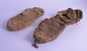 AN EXTREMELY RARE EARLY PAIR OF WOOLWORK SHOES probably