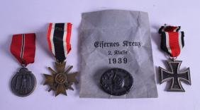 A GERMAN WWII NAZI MEDALLION together with three