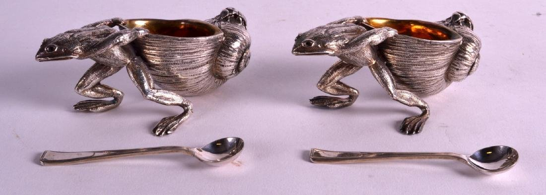 A LOVELY PAIR OF CONTINENTAL WHITE METAL NOVELTY SALTS