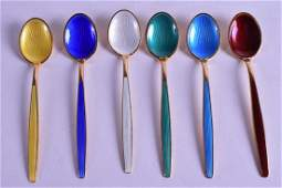A SET OF SIX NORWEGIAN SILVER GILT AND ENAMEL SPOONS by