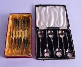 A Cased Set Of Six Silver Apostle Spoons Together With