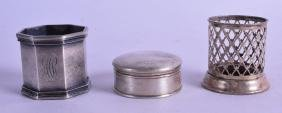 A STERLING SILVER NAPKIN RING together with a silver