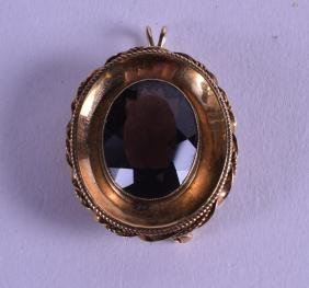 A VICTORIAN YELLOW GOLD AND TOPAZ PENDANT.