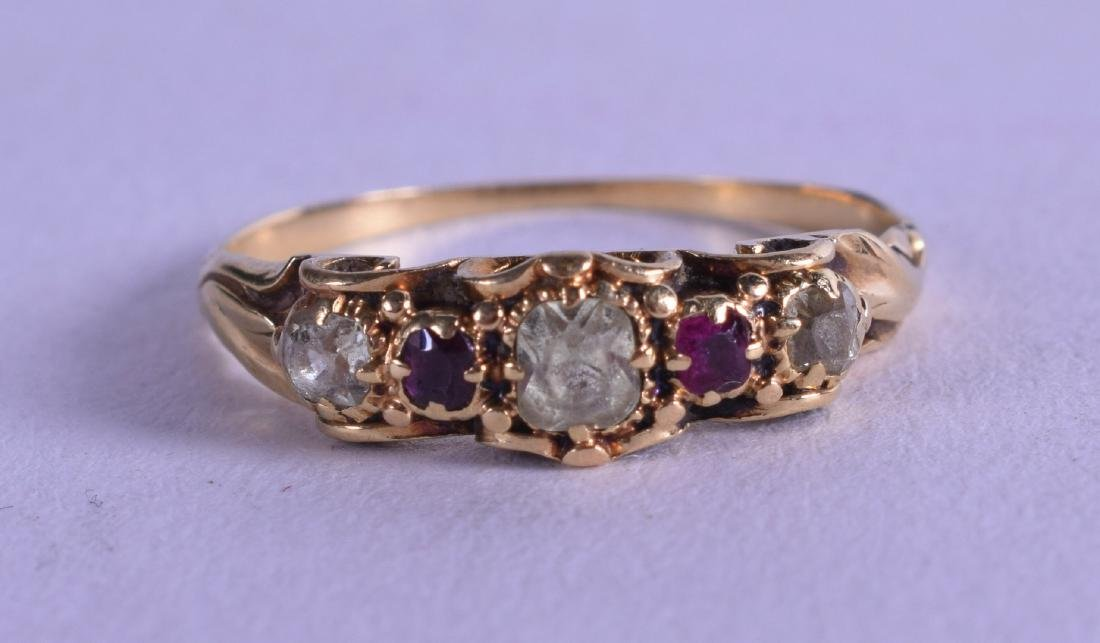 AN 18CT GOLD AND DIAMOND AND RUBY RING.