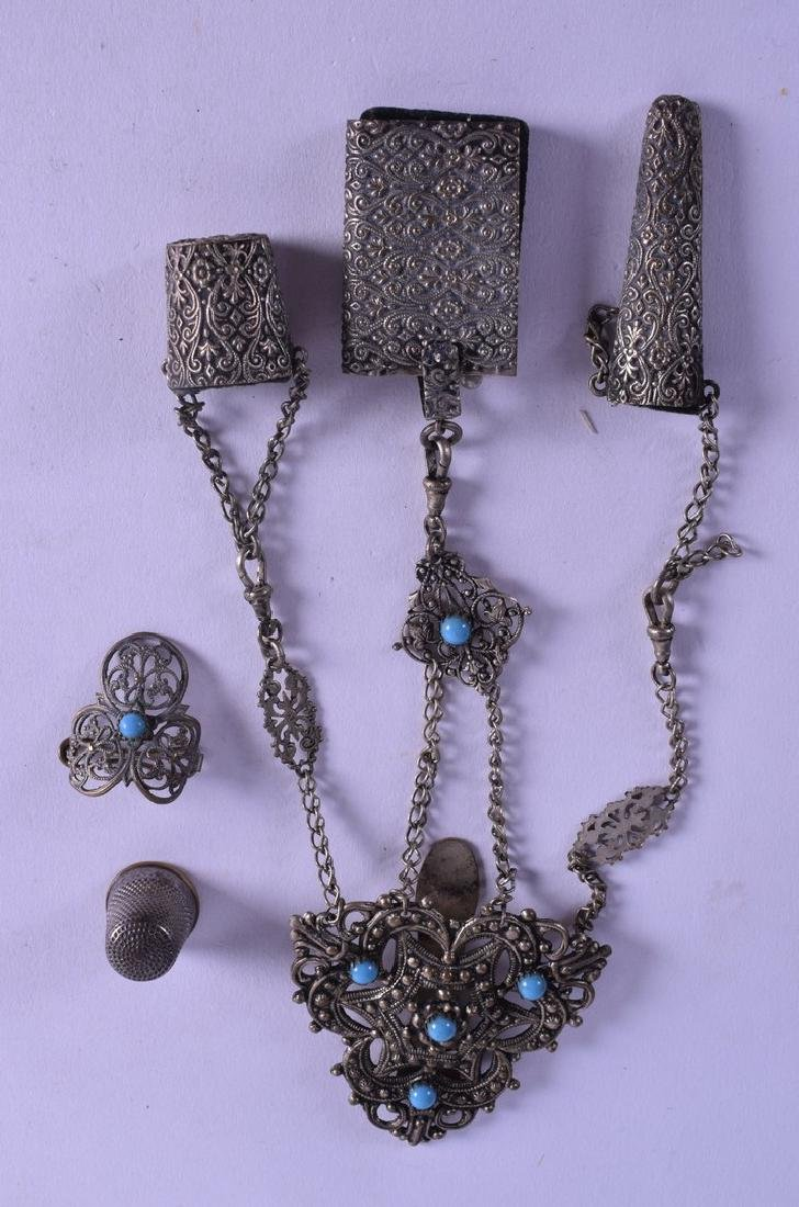 AN ANTIQUE WHITE METAL CHATELAINE together with a