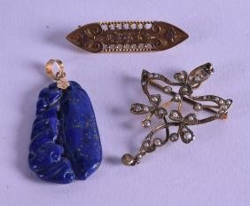 TWO GOLD MOUNTED PENDANTS together with a gold brooch.