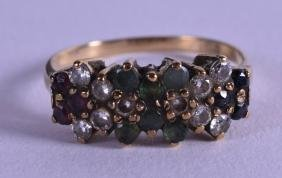 AN 18CT YELLOW GOLD DIAMOND RUBY AND EMERALD RING.
