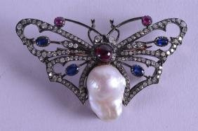 A VICTORIAN STYLE GOLD SILVER DIAMOND AND RUBY
