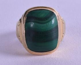 A GOLD AND MALACHITE RING.