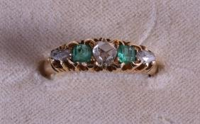 A VICTORIAN 18CT YELLOW GOLD EMERALD AND DIAMOND RING.