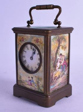 A FRENCH BRASS CARRIAGE CLOCK inset with painted enamel