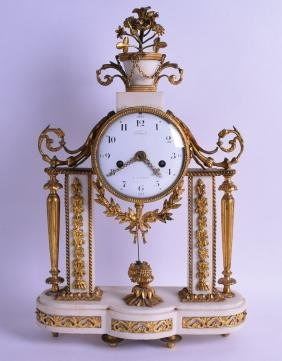 AN EARLY 19TH CENTURY FRENCH ORMOLU AND WHITE MARBLE