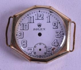 A VINTAGE GOLD CASED ROLEX WATCH with white enamel