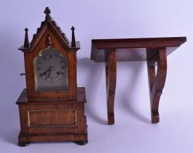 A VICTORIAN ROSEWOOD GOTHIC REVIVAL CARVED CLOCK with