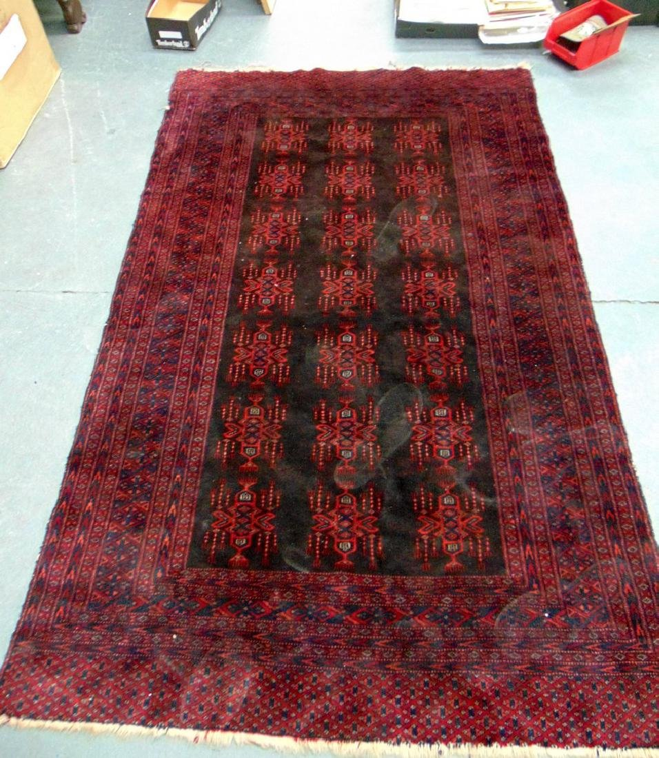 A RED GROUND PERSIAN RUG, decorated with motifs. 195 cm