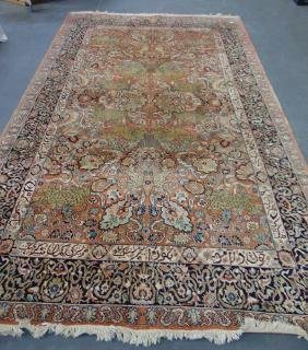 A LARGE ORIENTAL CARPET decorated with animals and