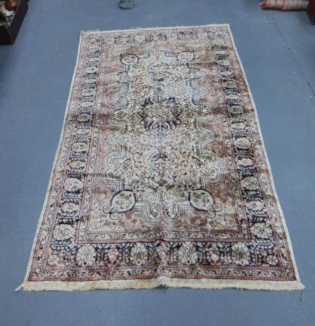 A BEIGE GROUND PERSIAN RUG, decorated with flowers. 202