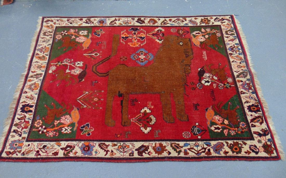AN UNUSUAL EASTERN RUG, decorated with animals and