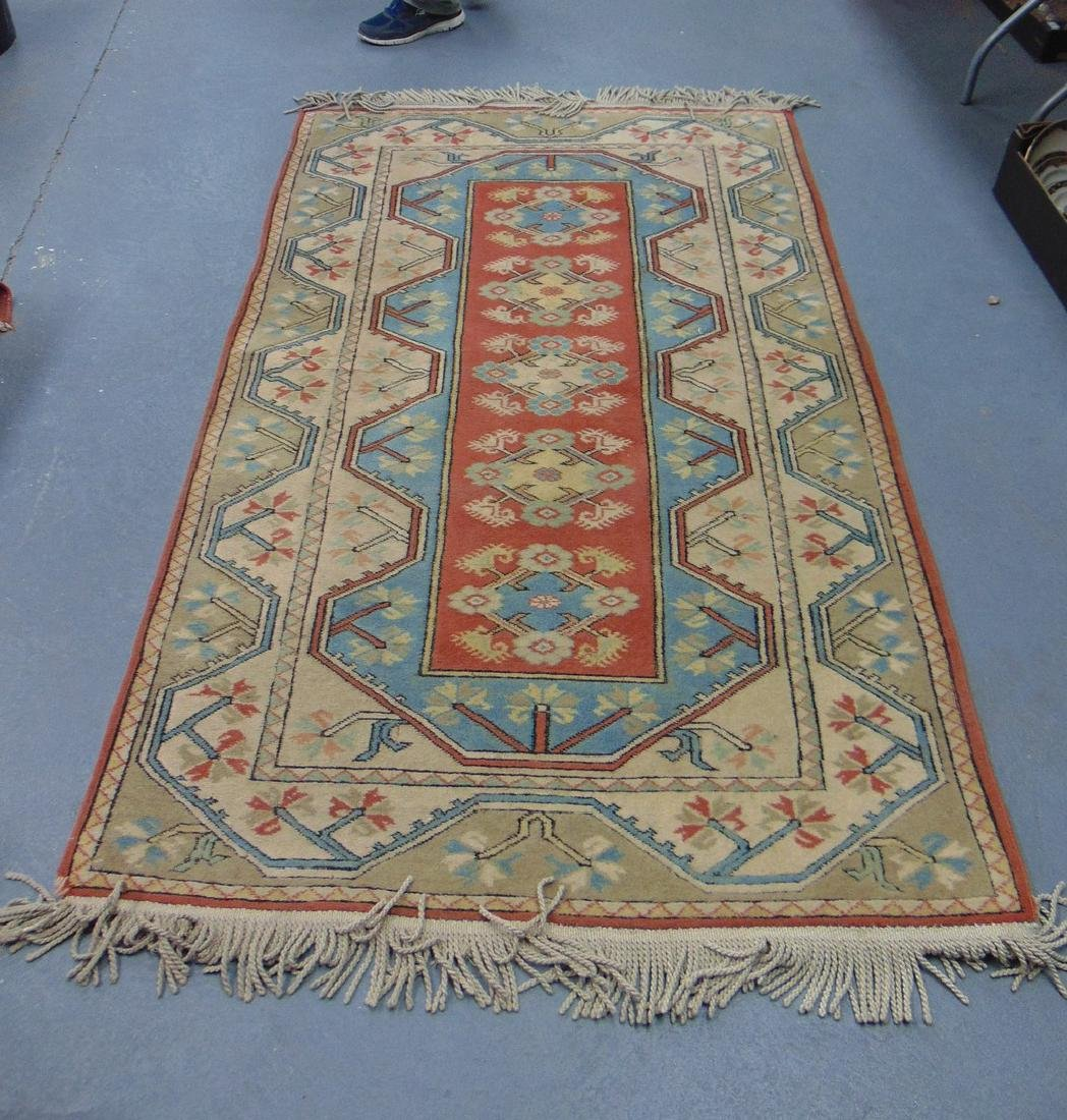 A BLUE GROUND PERSIAN RUG, decorated with flowers. 216