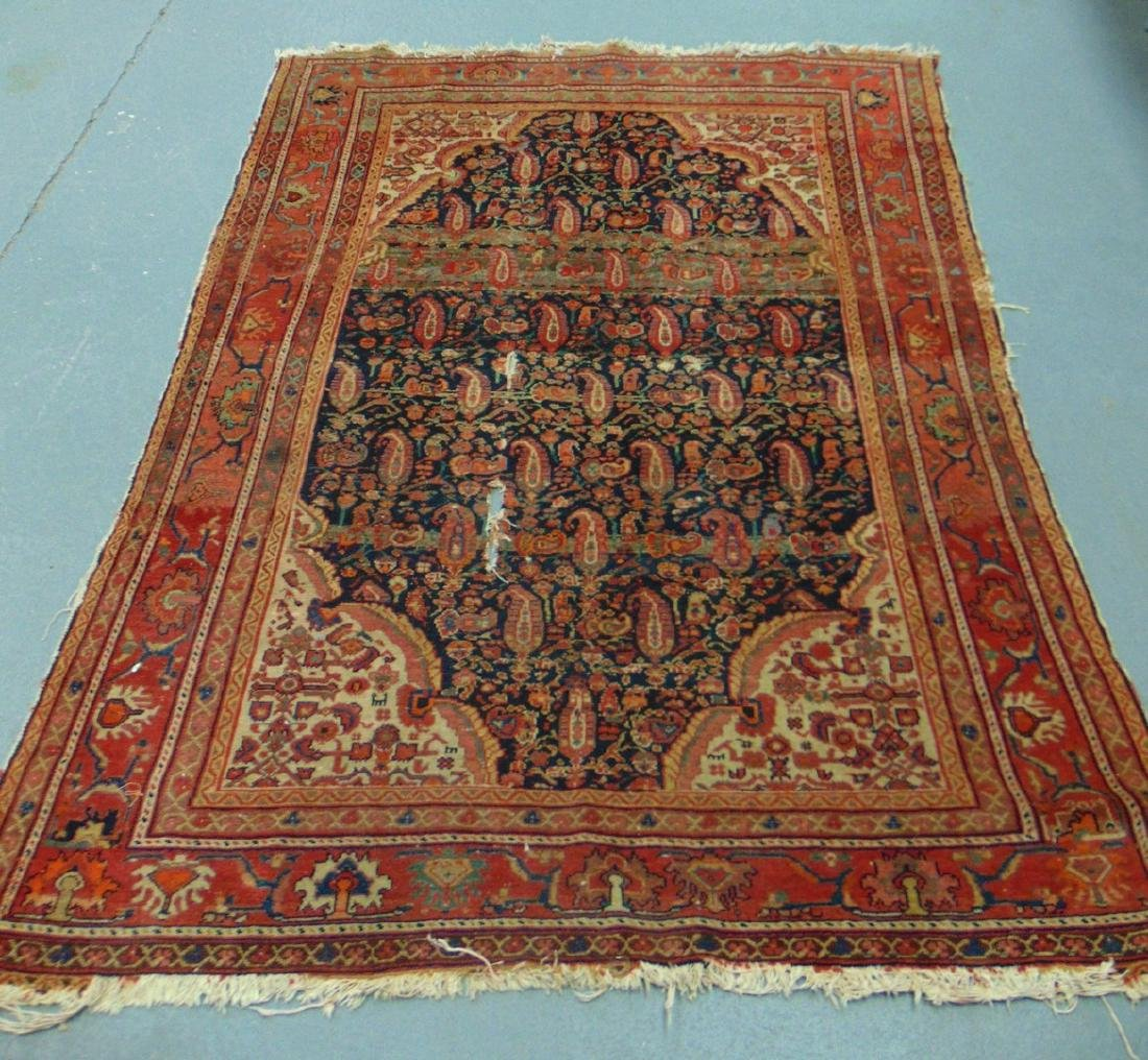 AN EARLY 20TH CENTURY PERSIAN RUG, decorated with
