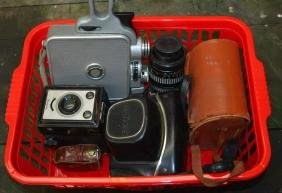 A BOX OF VARIOUS VINTAGE CAMERAS together with a lens.