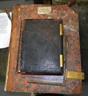 A LARGE ANTIQUE HOLY BIBLE together with a leather