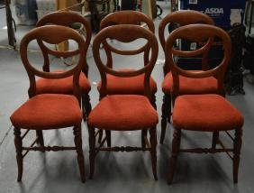 A SET OF SIX VICTORIAN STYLE HOOP BACK DINING CHAIRS