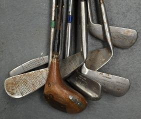 A COLLECTION OF EIGHT VINTAGE GOLF CLUBS including R