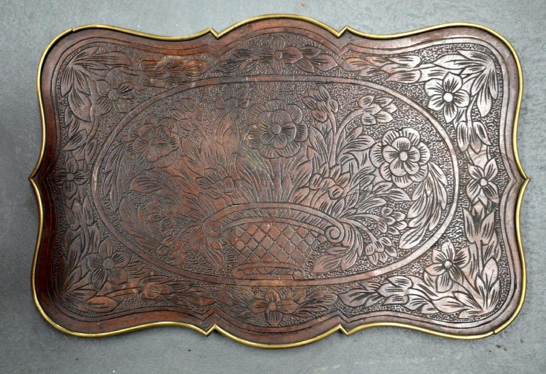 AN ANTIQUE CONTINENTAL BRASS MOUNTED WOODEN TRAY.