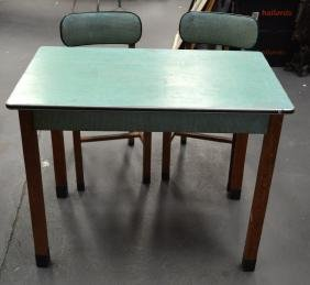 A RETRO CANTEL KITCHEN TABLE with two chairs. (3)