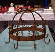 A FRENCH WROUGHT IRON GAME HANGING RACK.