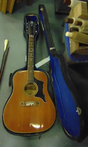 A CASED MODEL 612 NEVADA ACOUSTIC GUITAR.