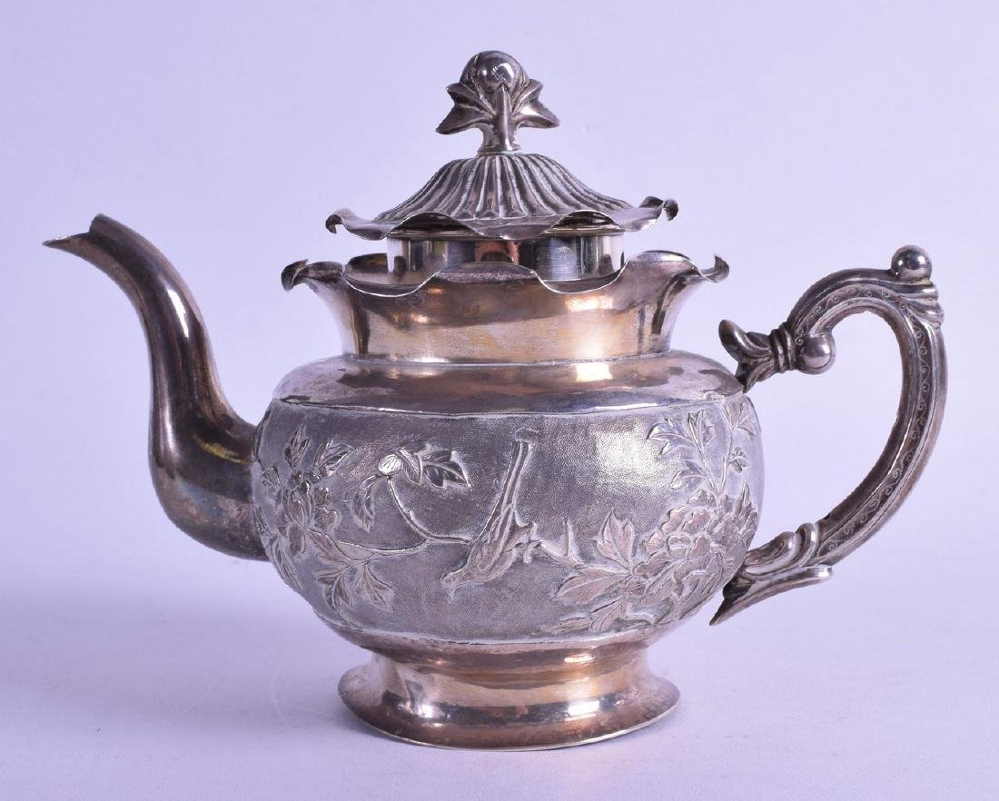A LATE 19TH CENTURY CHINESE EXPORT SILVER TEAPOT AND