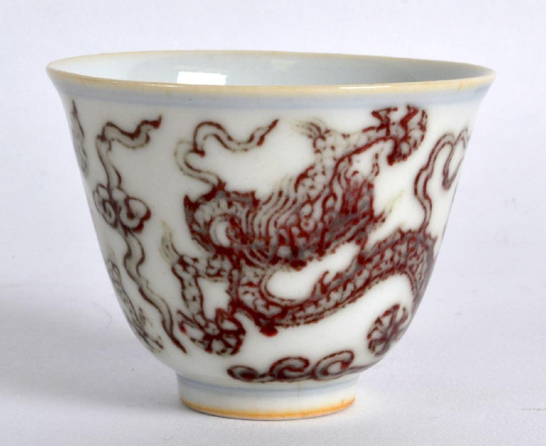 A CHINESE IRON RED GLAZED PORCELAIN TEABOWL bearing