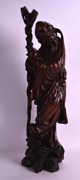 A LARGE 19TH CENTURY CHINESE CARVED HARDWOOD FIGURE OF
