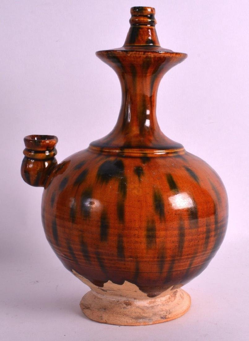 AN EARLY CHINESE SPINACH AND EGG GLAZED POTTERY EWER