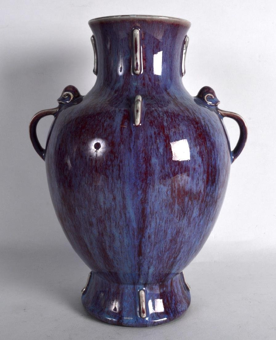 A CHINESE TWIN HANDLED FLAMBE GLAZED PORCELAIN VASE
