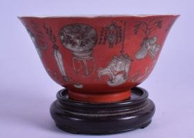 A CHINESE QING DYNASTY CORAL GROUND SCALLOPED BOWL