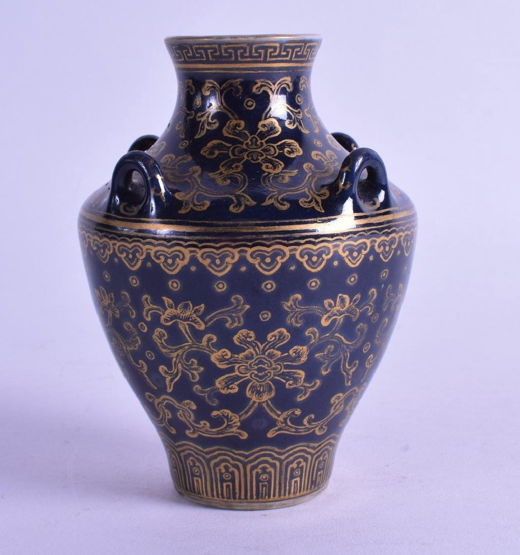 A 19TH CENTURY CHINESE BLUE GROUND BALUSTER VASE
