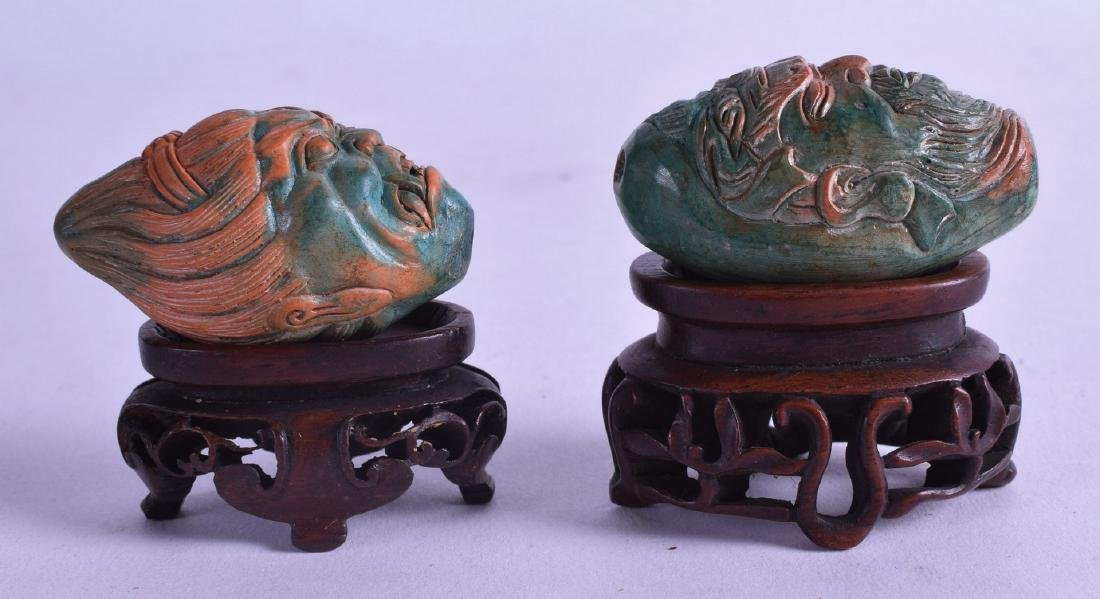 AN UNUSUAL PAIR OF HARDSTONE BUDDHISTIC GOD HEADS upon